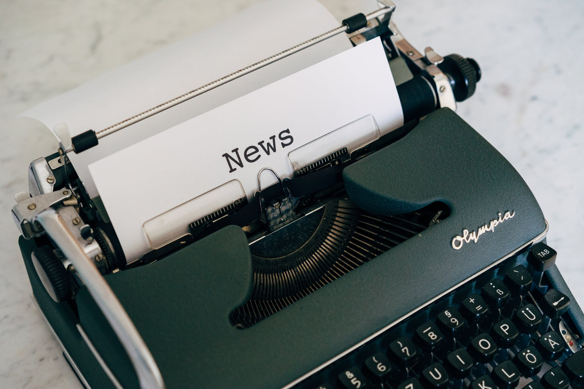 Old typewriter with the word News typed on the sheet of paper.