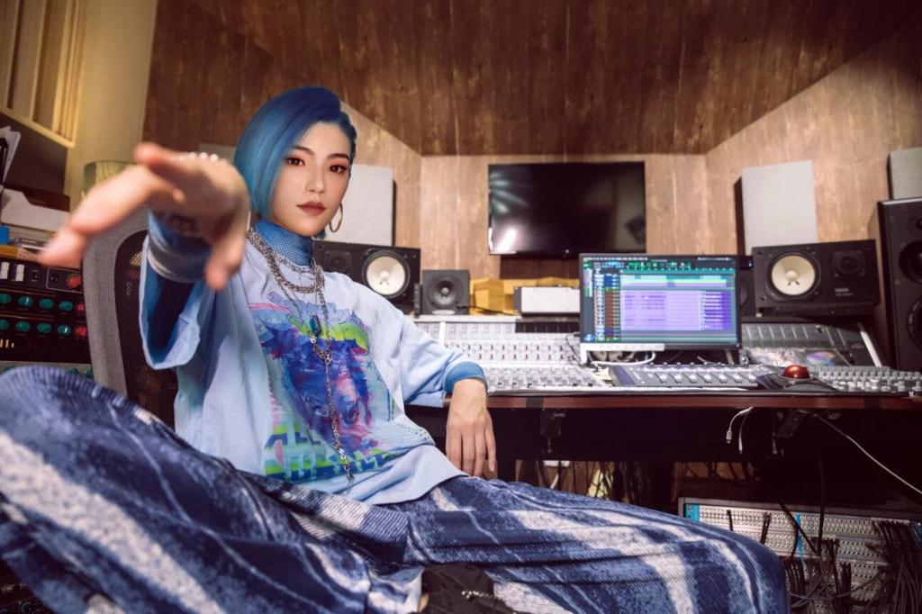 Virtual ops star Hi Jiang sitting in a recording studio.